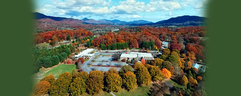 Campus of Haywood Community College seen from the air.  Trees are in fall color.